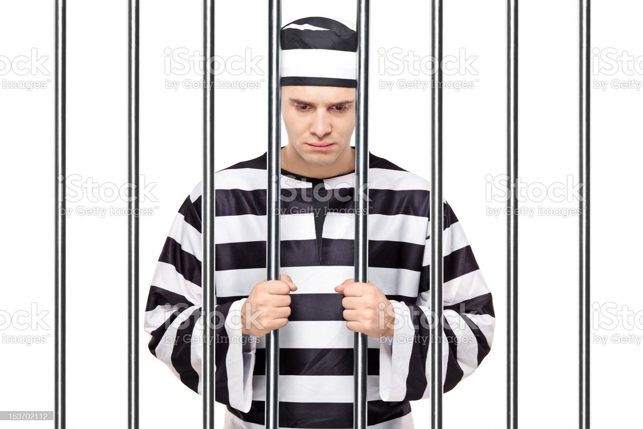 Sad prisoner in jail royalty-free stock photo