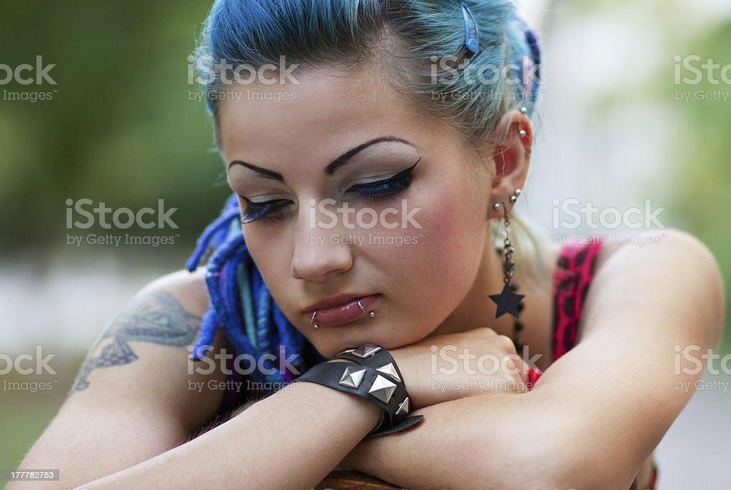 Sad punk girl posing outdoors stock photo