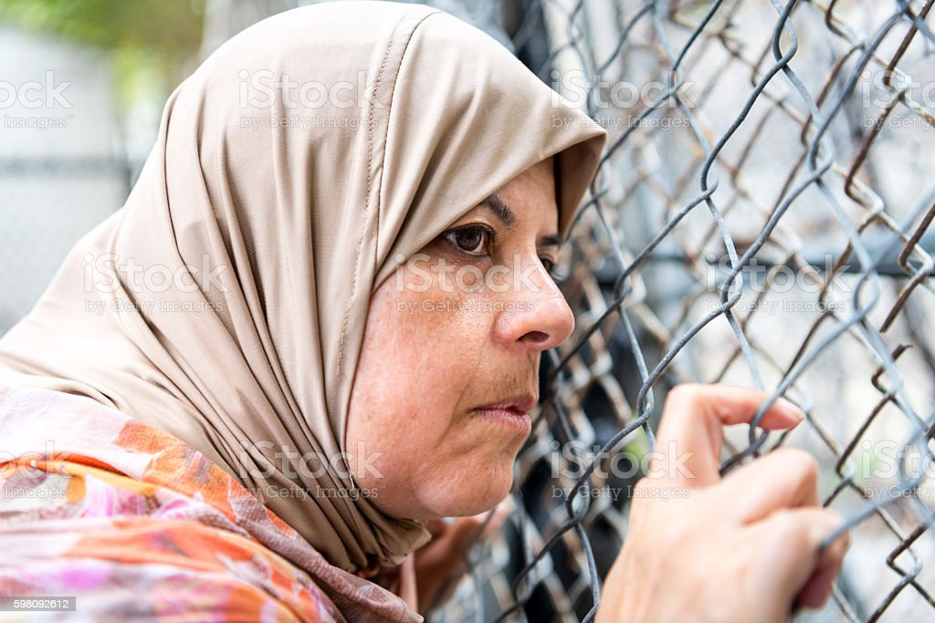 Sad refugee Middle eastern woman (Real People) stock photo