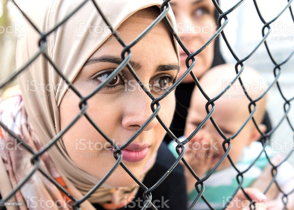 Sad refugee Middle eastern women (Real People) stock photo