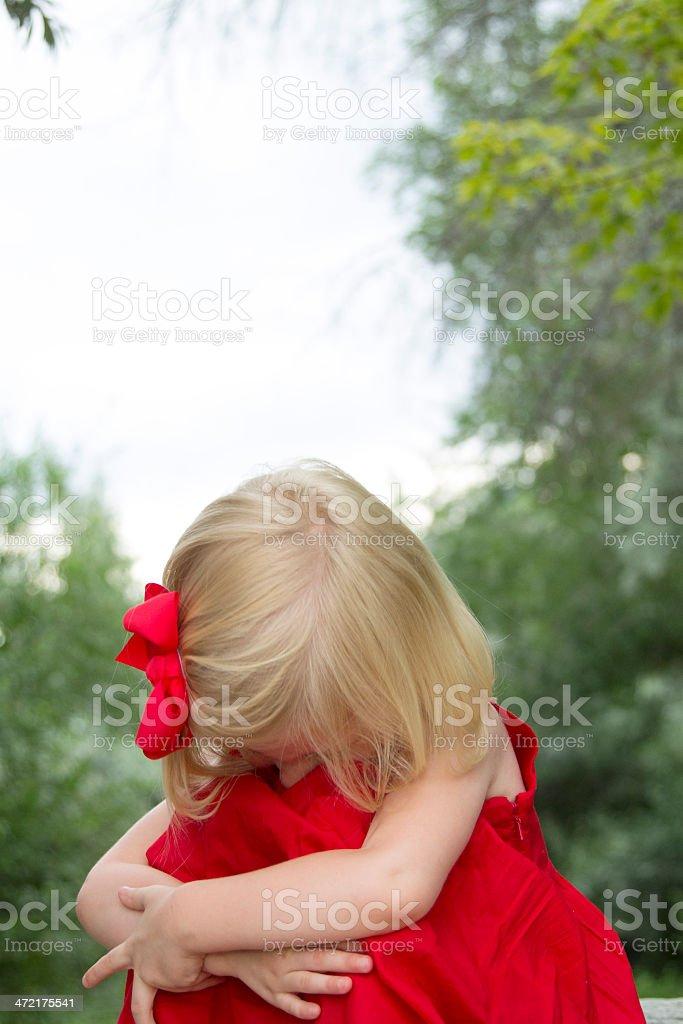 Sad, Scared child buries face stock photo