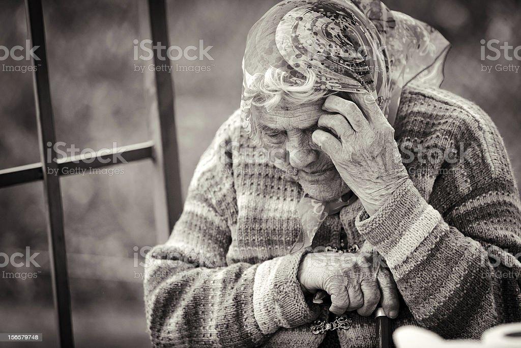 Sad senior lady stock photo