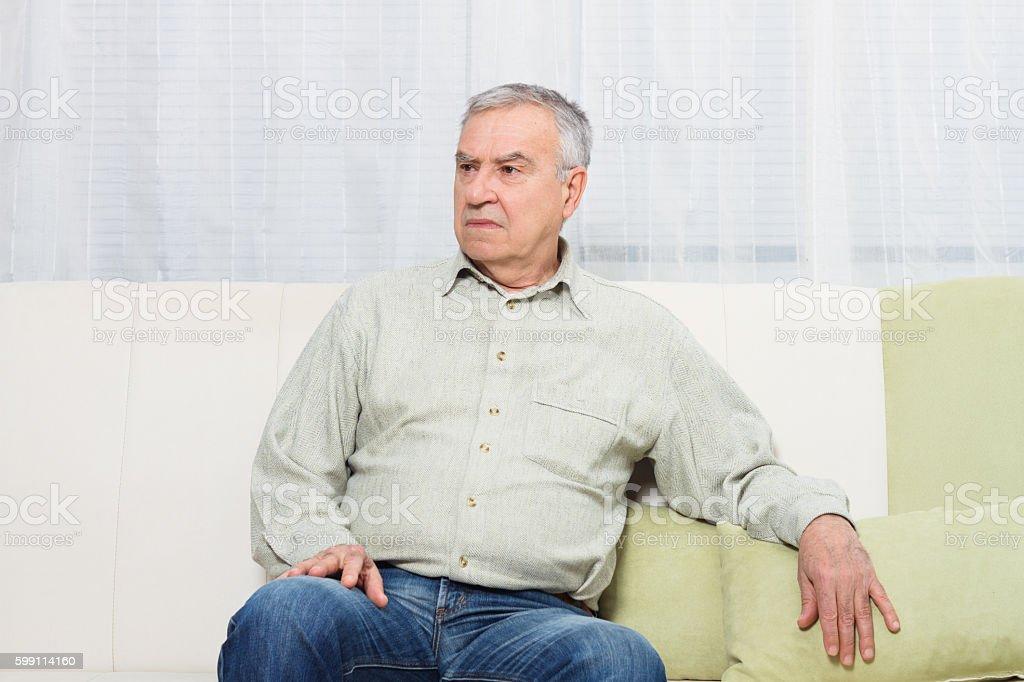 Sad senior man stock photo