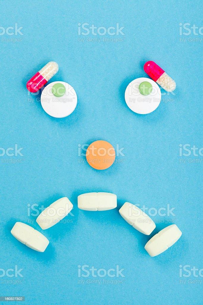 Sad smileyface made of pills royalty-free stock photo