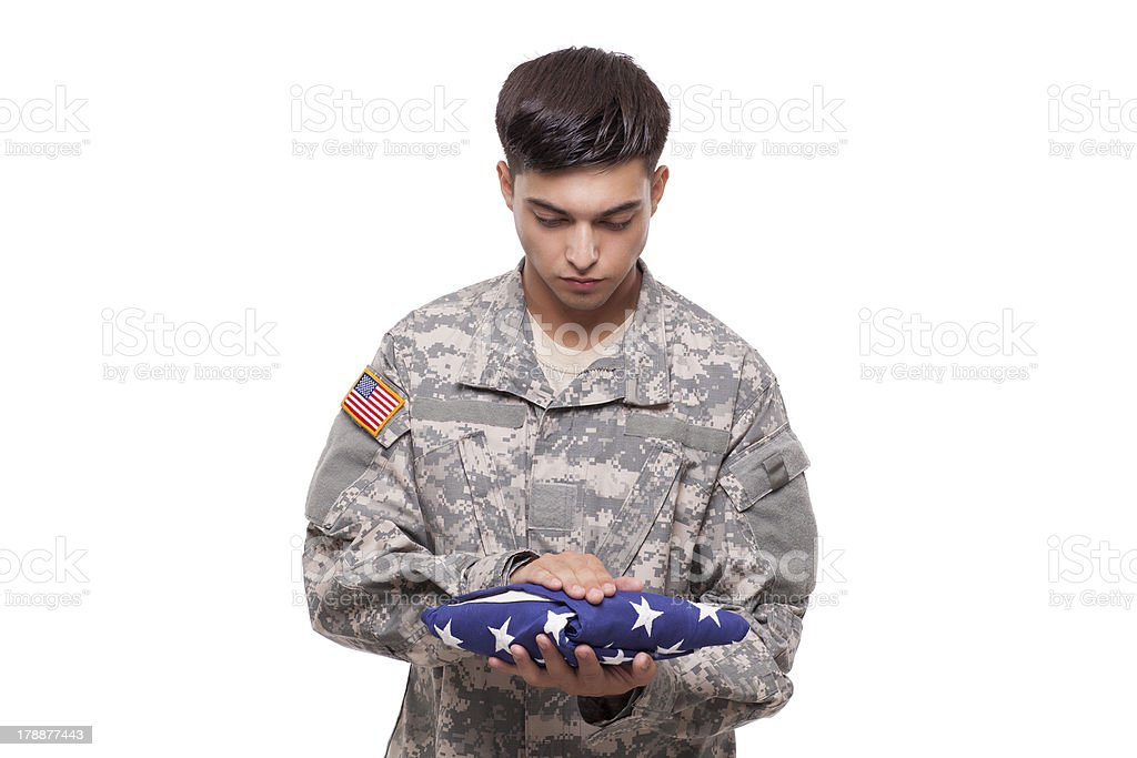 Sad soldier with an American flag royalty-free stock photo