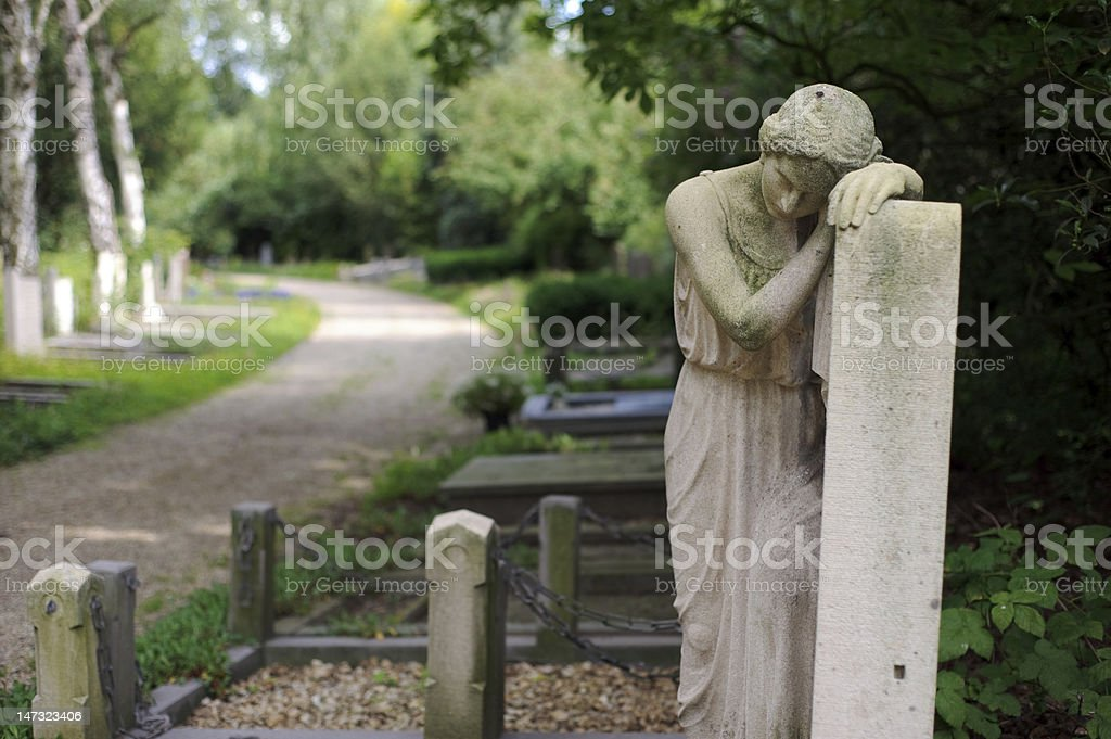 Sad statue at cemetery royalty-free stock photo