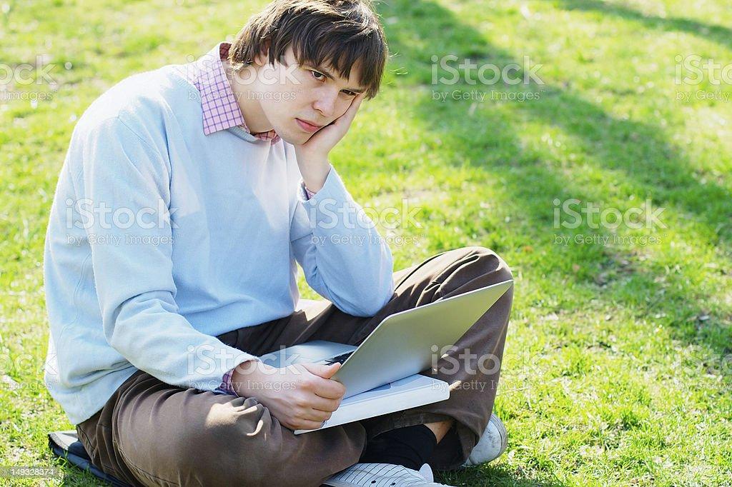 Sad student outdoors royalty-free stock photo