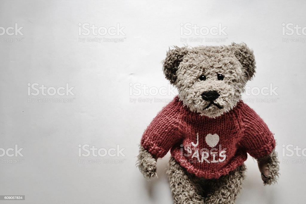 Sad teddy bear with Paris sweatshirt stock photo