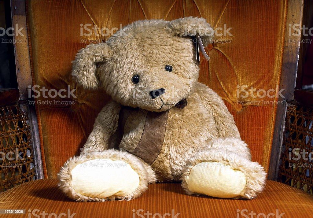 Sad Teddy on a chair stock photo