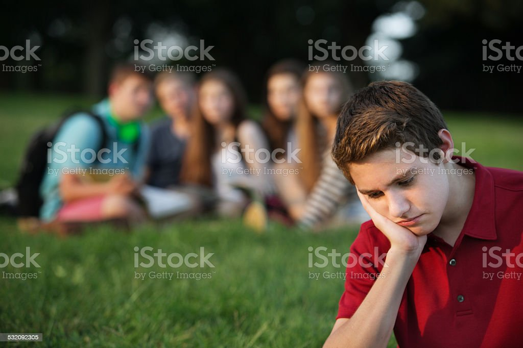 Sad Teen in Red stock photo