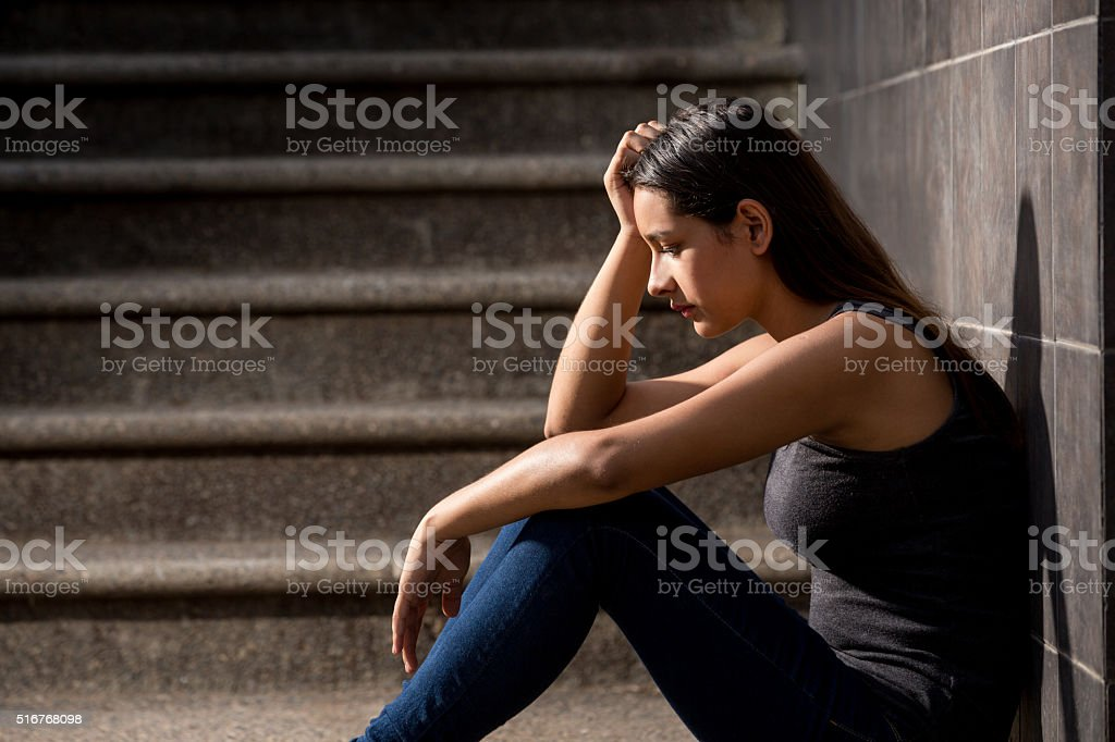 Sad teenage girl stock photo