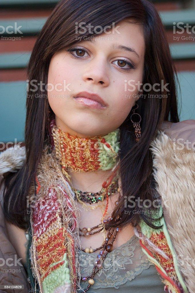Sad Teenage Girl Sitting on Steps Outside stock photo