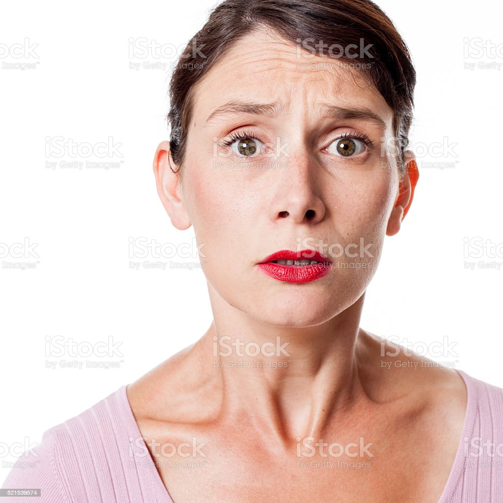 sad tensed young woman expressing anxiety and consternation stock photo