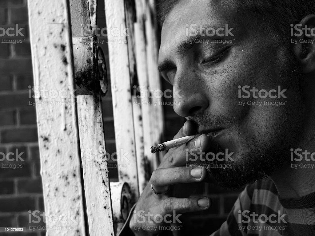 Sad thoughts behind bars stock photo