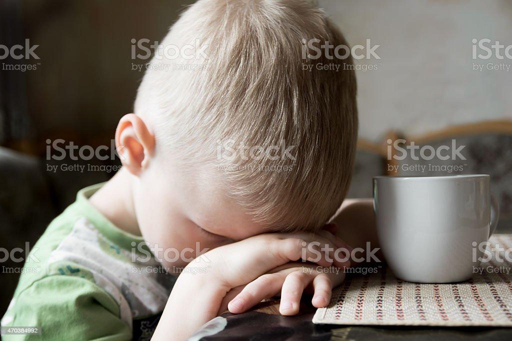 Sad tired child stock photo
