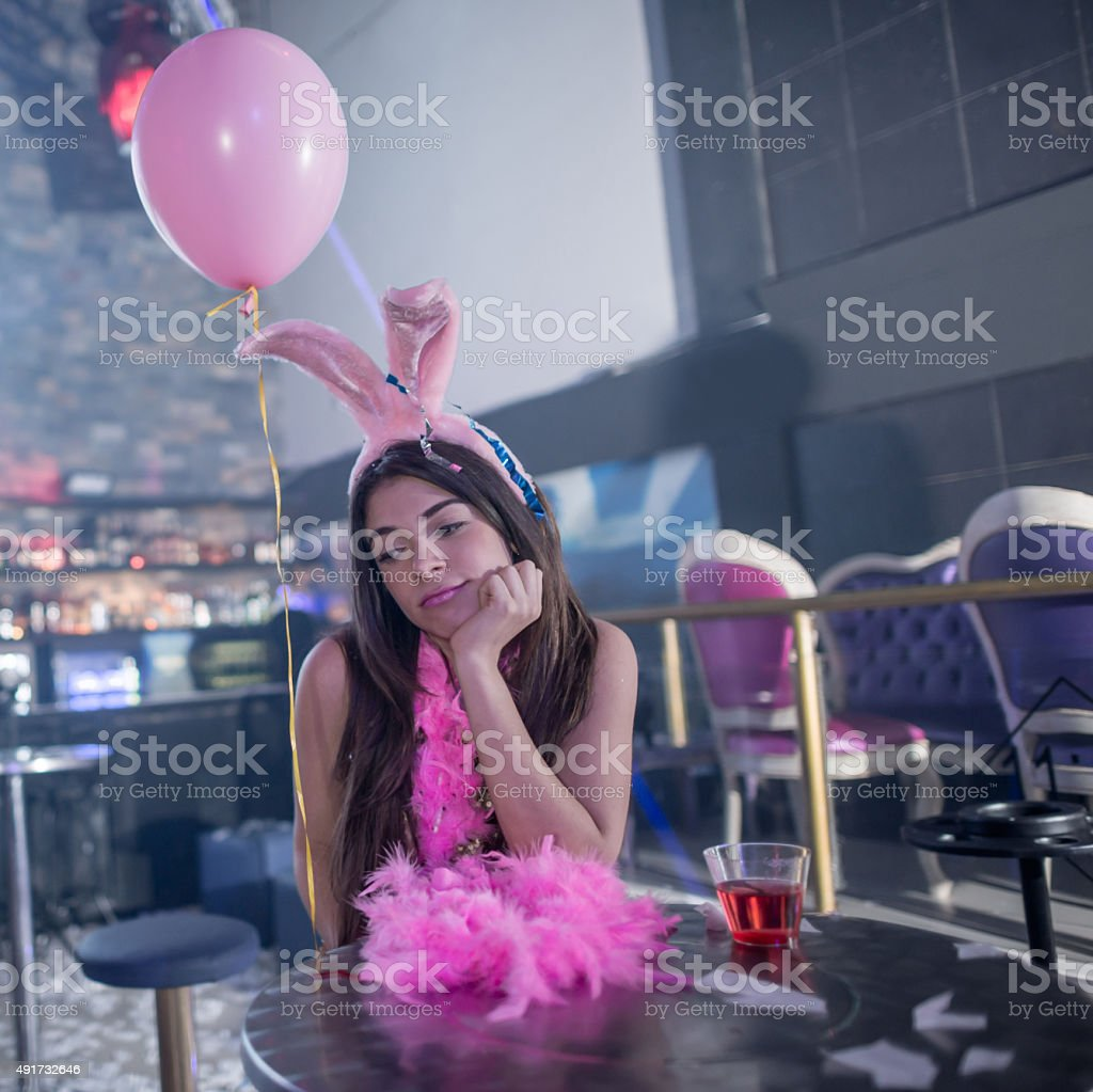Sad woman at the end of a bachelorette party stock photo