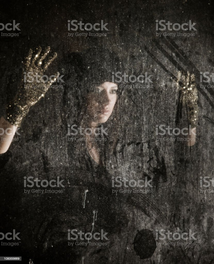 Sad woman behind the window glass royalty-free stock photo