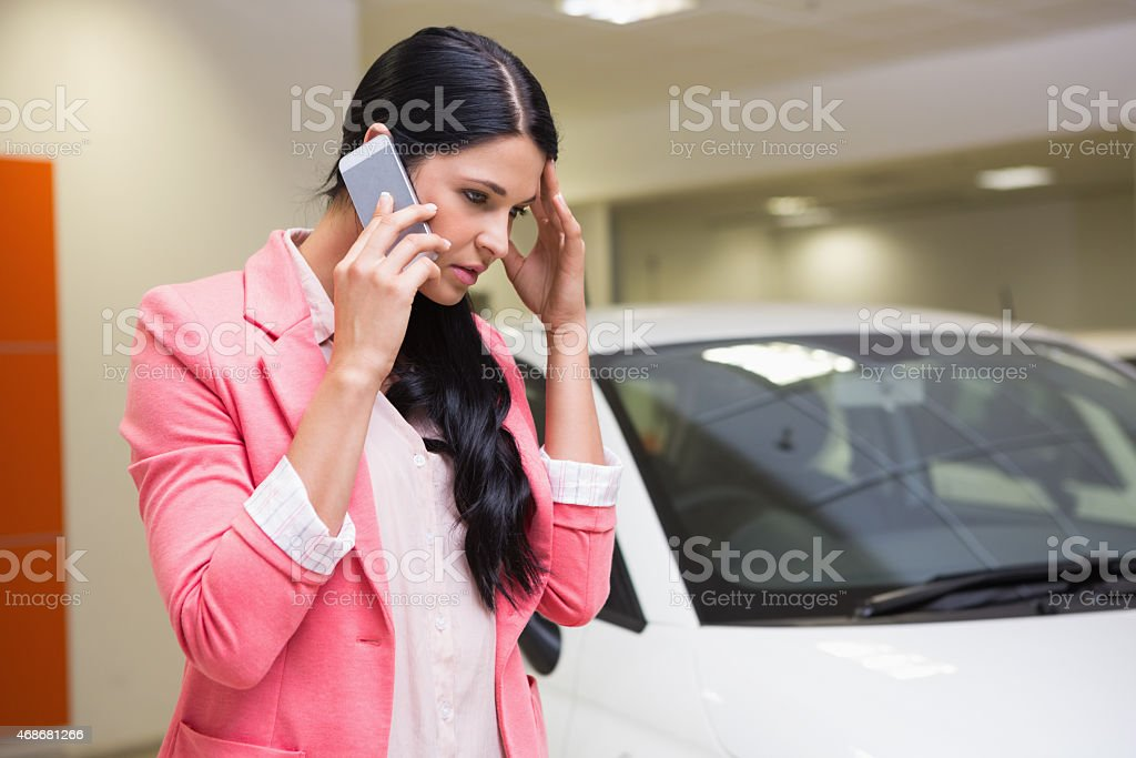 Sad woman calling someone with her mobile phone stock photo