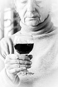 Sad woman holding a glass of red wine