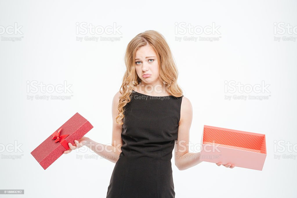 Sad woman holding empty gift box stock photo