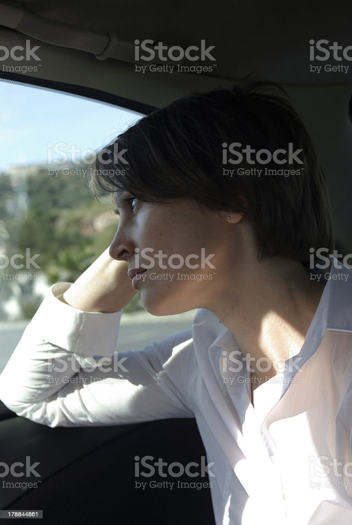 Sad woman in car royalty-free stock photo
