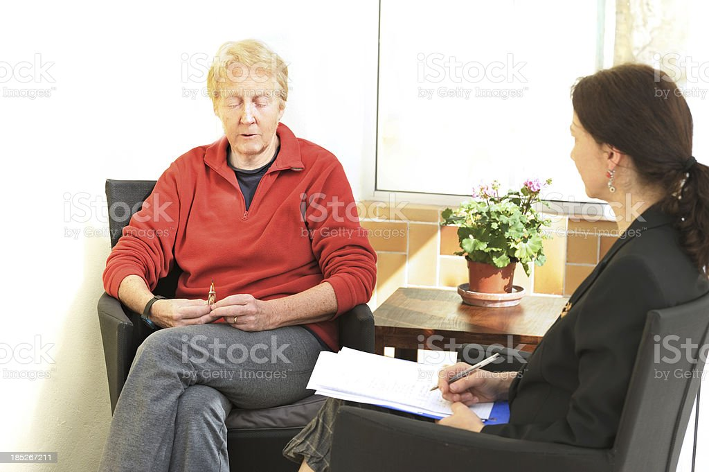 Sad woman in counselling session royalty-free stock photo