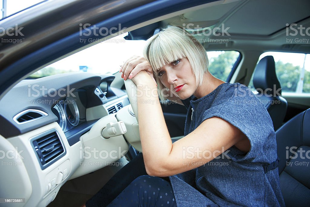 sad woman in her car royalty-free stock photo