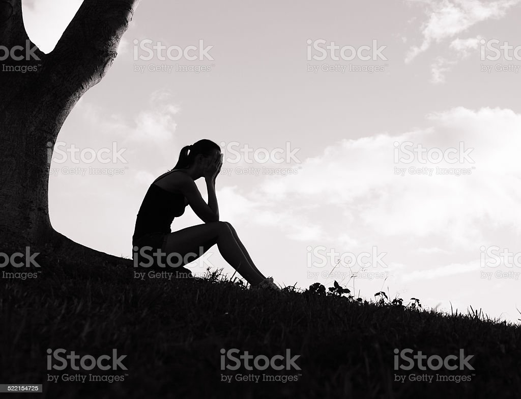 Sad woman in the park stock photo