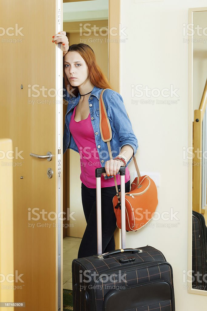 Sad woman leaving  home royalty-free stock photo