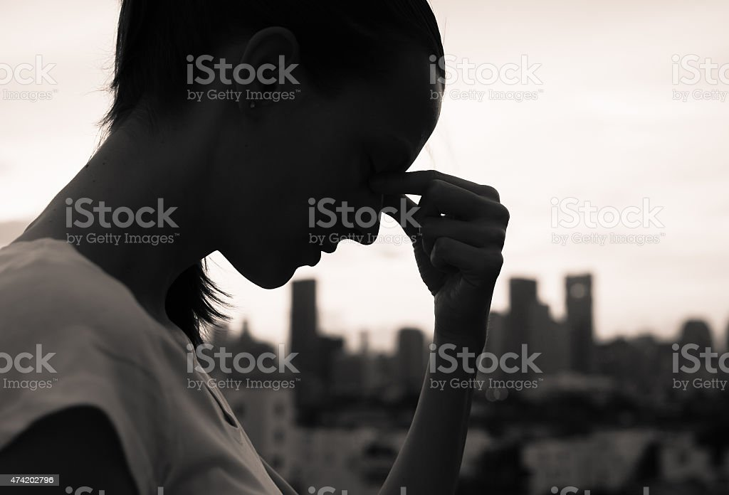 Sad woman n the city stock photo