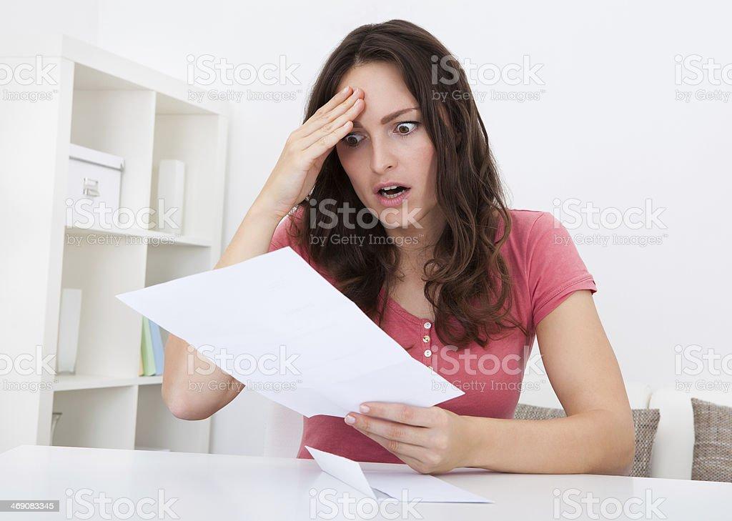 Sad Woman Reading Paper stock photo