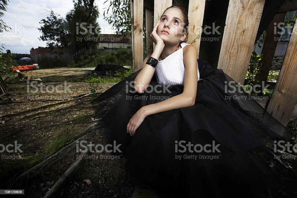 Sad Woman Sitting Outside stock photo