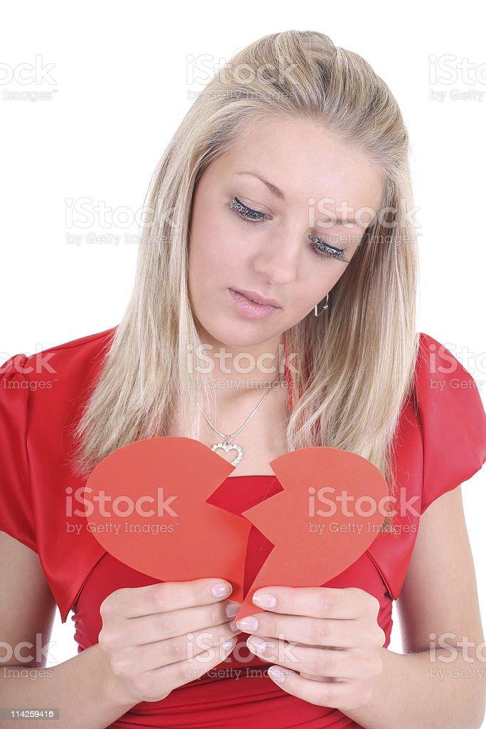 Sad woman with broken heart stock photo