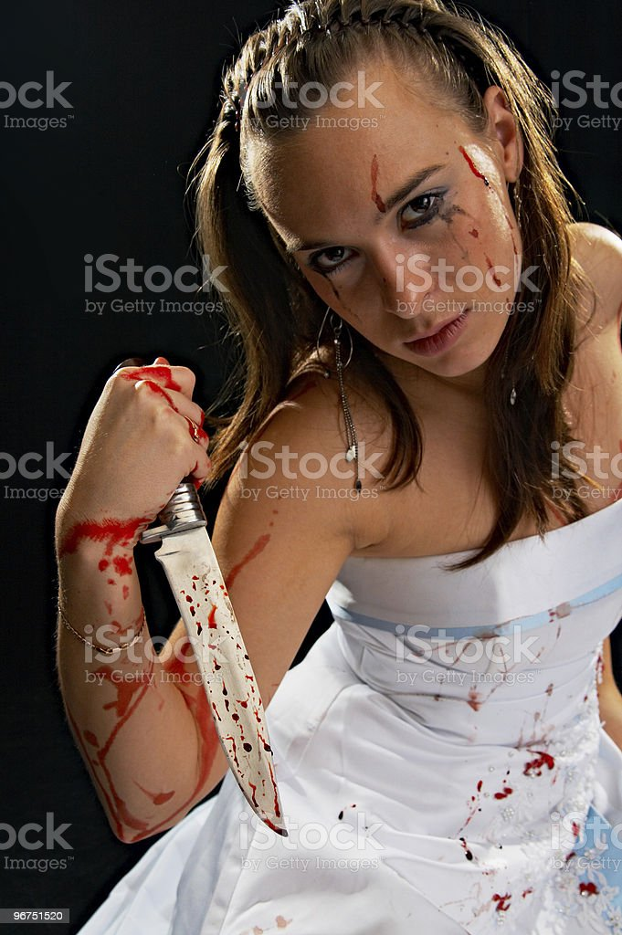 sad woman with knife royalty-free stock photo