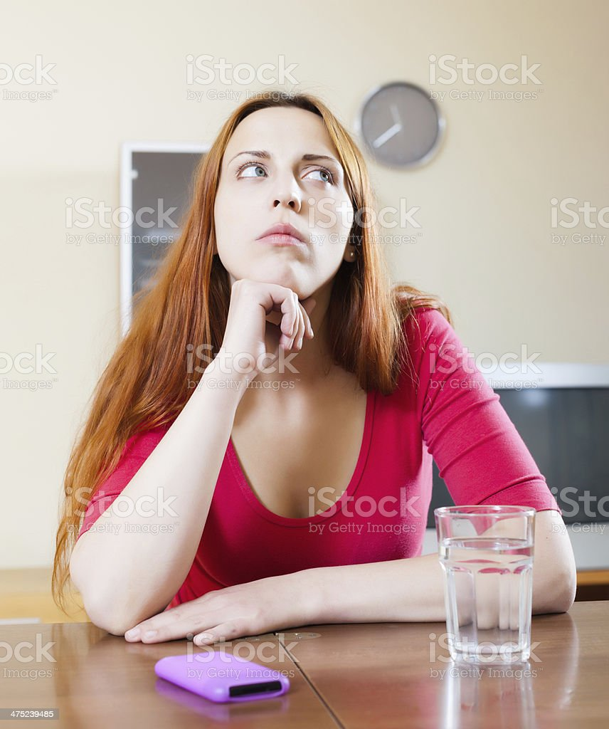 Sad woman with mobile royalty-free stock photo