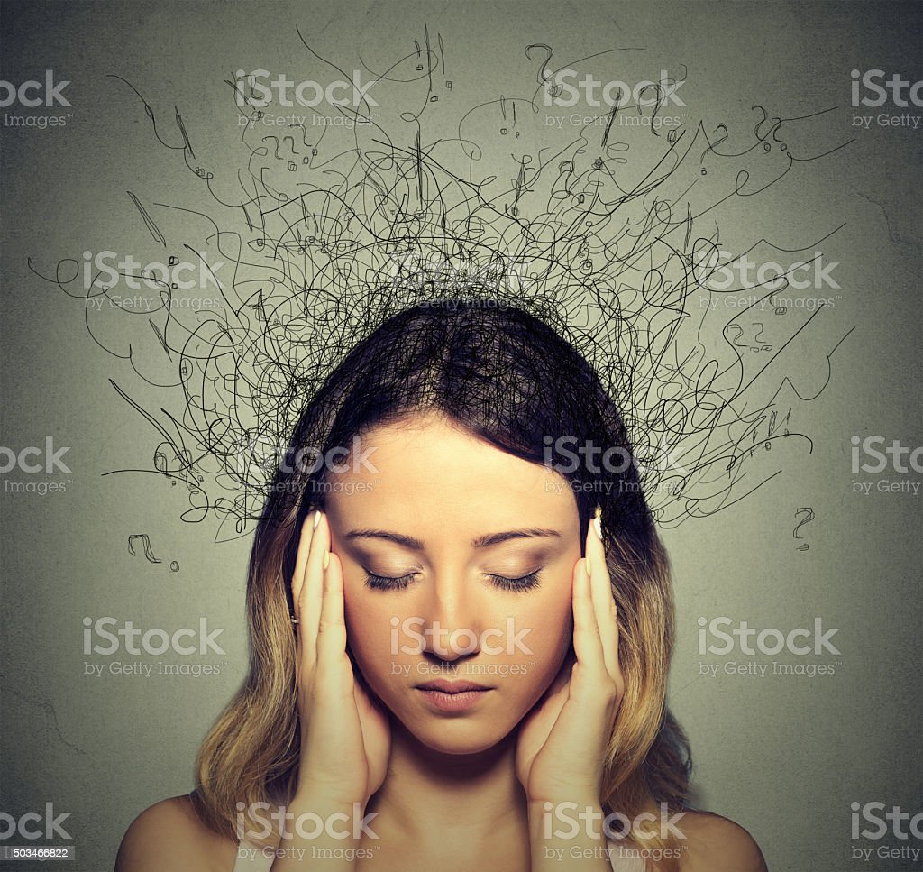 sad woman with worried stressed expression brain melting into lines stock photo