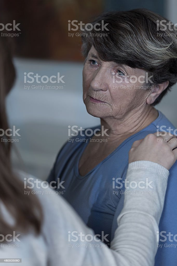 Sad women talk with friend stock photo
