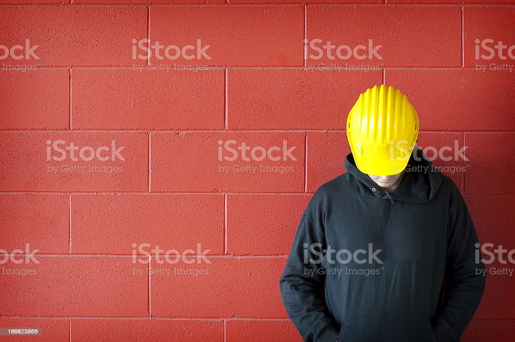 Sad worker against red wall stock photo