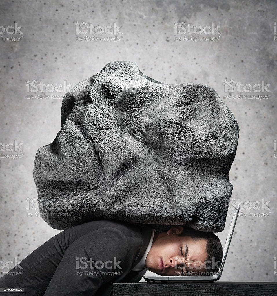 Sad Young Businessman Stressed at the workplace stock photo