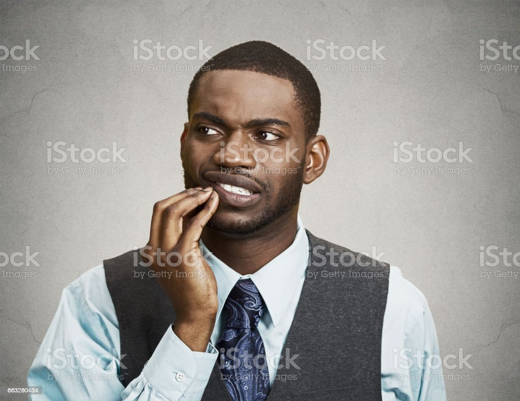 sad young executive man, student, worker touching face having bad pain, tooth ache stock photo