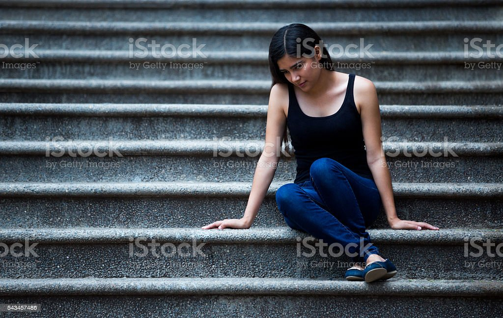 Sad young Latin woman stock photo