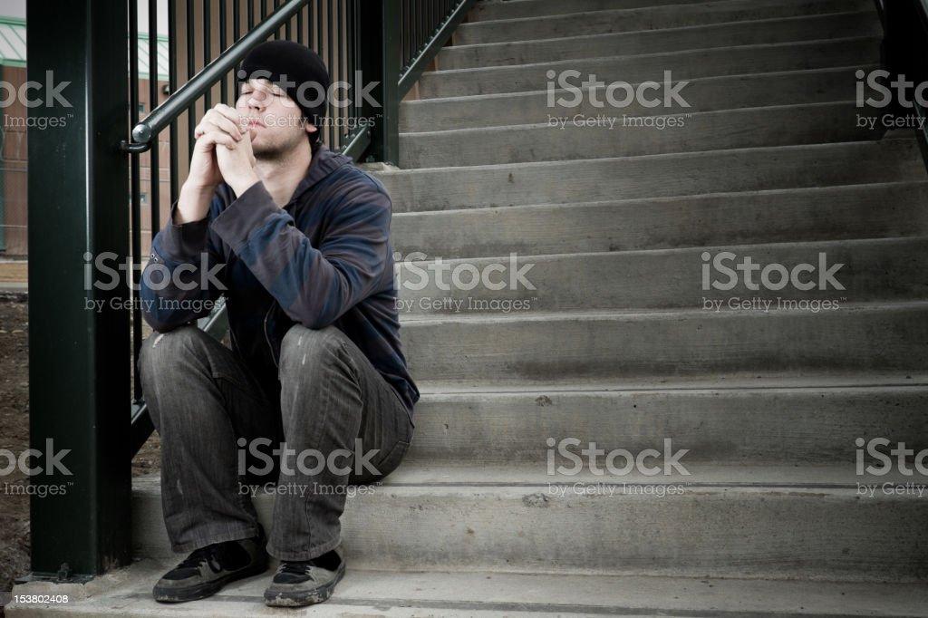 Sad Young Man Praying stock photo