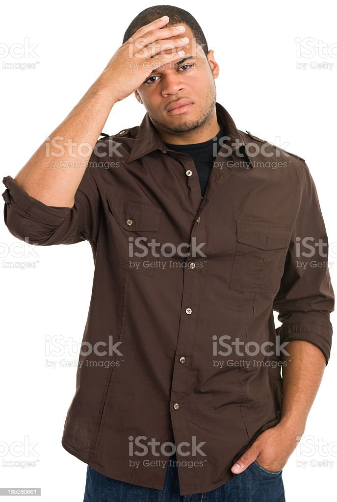 Sad Young Man Rubs Forehead royalty-free stock photo