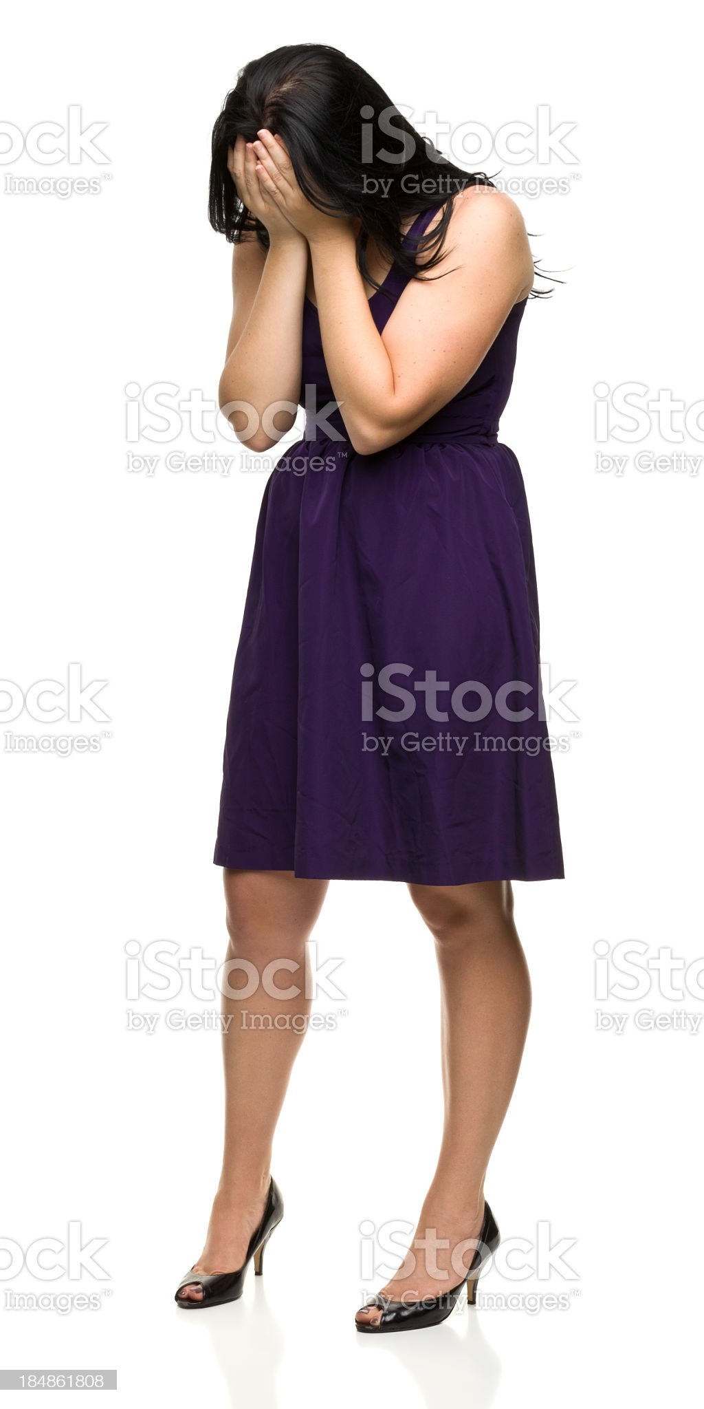Sad Young Woman Covers Face With Hands royalty-free stock photo
