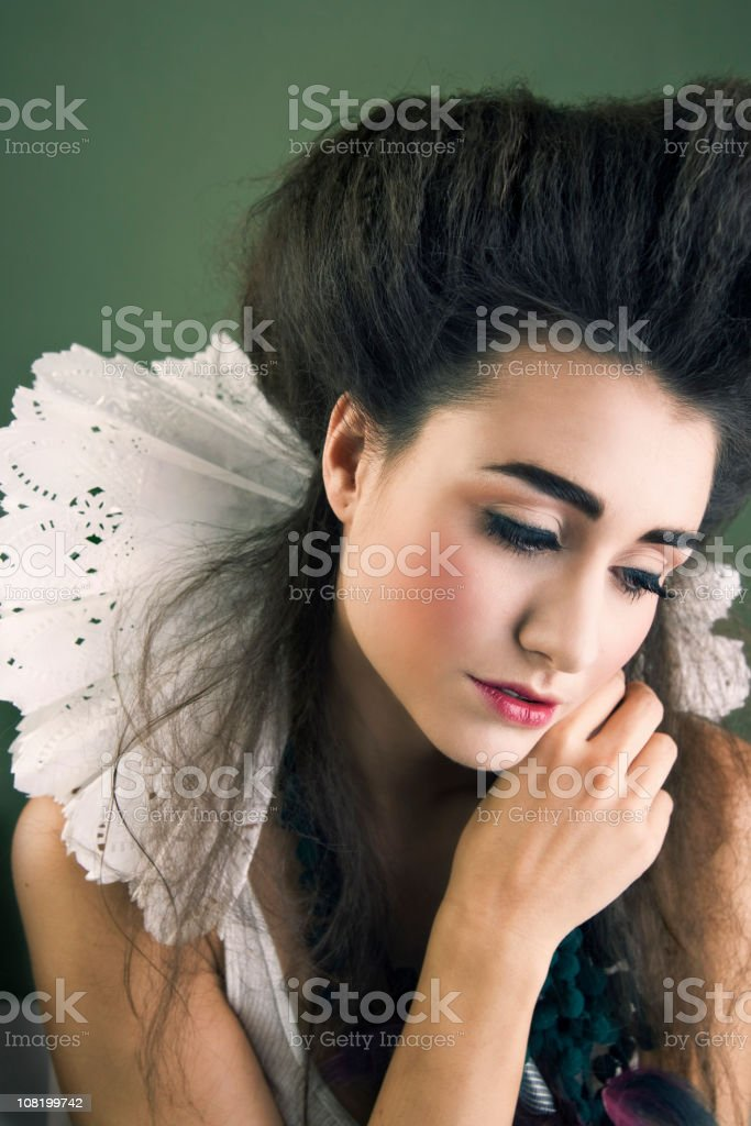 Sad Young Woman Dressed as Contemporary Queen royalty-free stock photo
