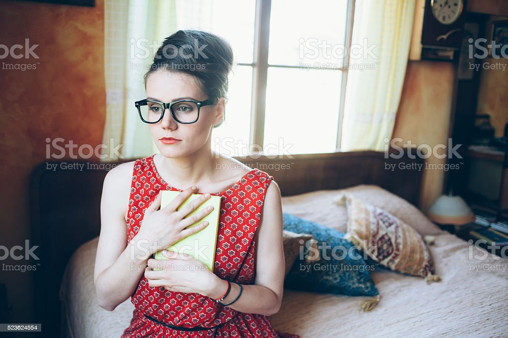 Sad young woman holding a picture frame stock photo