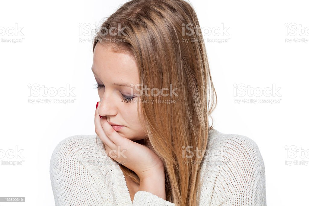Sad young woman isolated stock photo