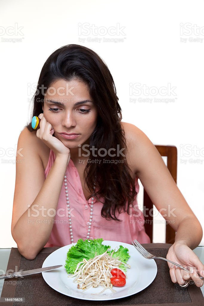 Sad young woman on a diet royalty-free stock photo