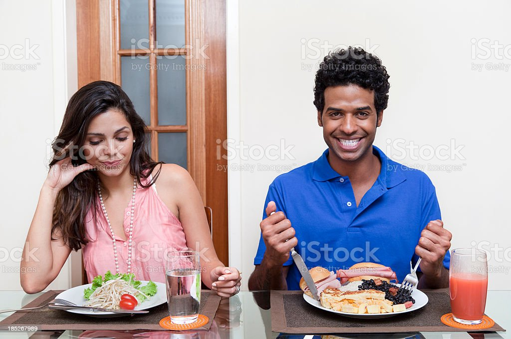 Sad young woman on a diet... royalty-free stock photo