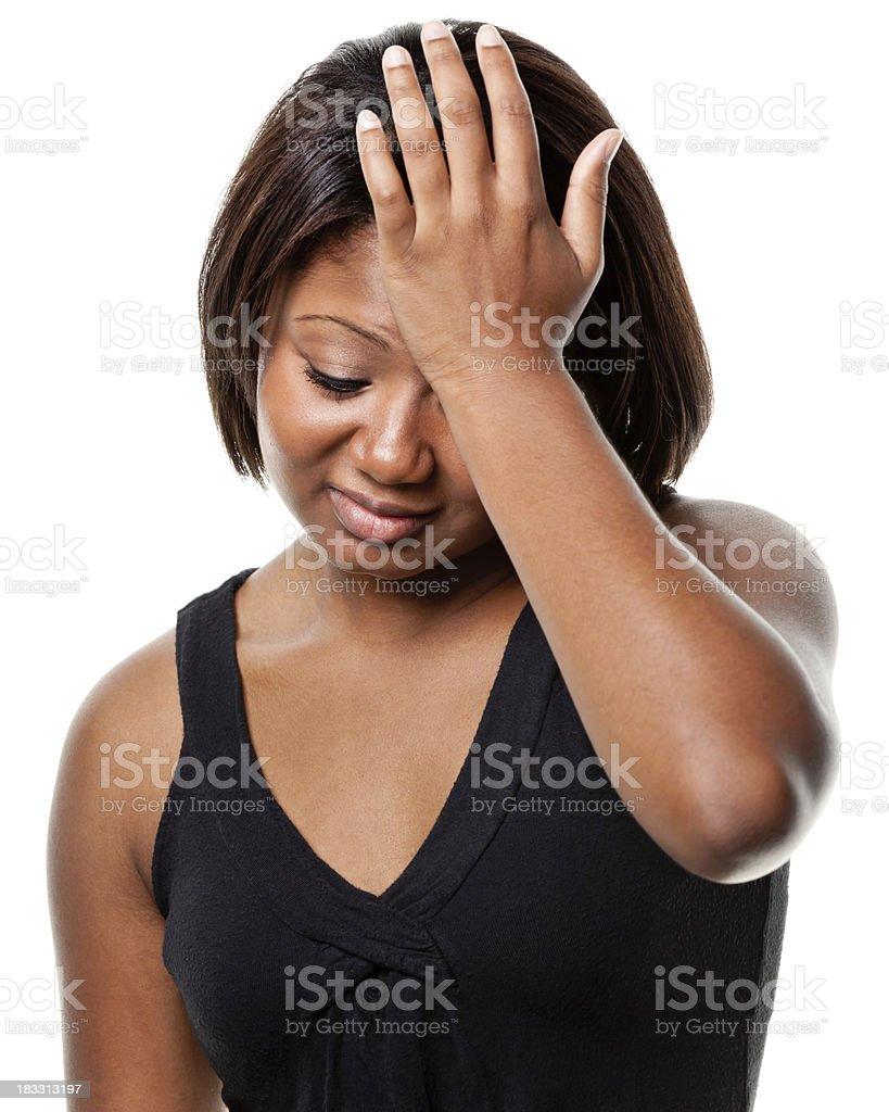Sad Young Woman Rubs Forehead royalty-free stock photo